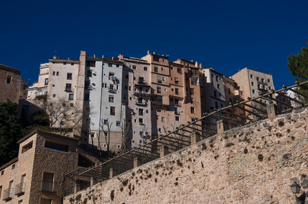 View to hanging houses of Cuenca old town.  Example of a medieval city, built on the steep sides of a mountain. Many houses are built right up to the cliff edge. Cuenca, Spain Stock Photo