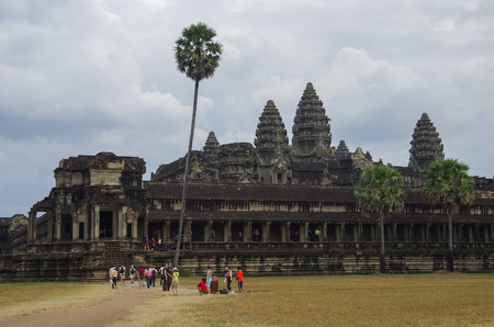 Tourists near Angkor Wat - Khmer temple in Siem Reap province, Cambodia, Southeast Asia. UNESCO World Heritage Site. Stock Photo