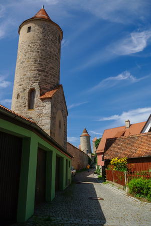 City walls and towers of Dinkelsbuhl, one of the archetypal medieval towns on the German Romantic Road. Germany Stock Photo