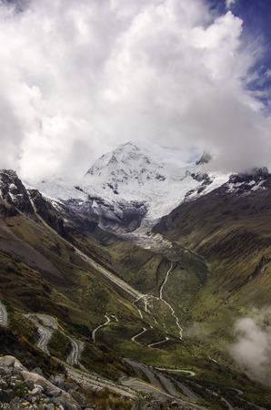 Mountain pass in Huascaran National Park, with Huascaran mount at background. Cordillera Blanca. Peru. Stock Photo