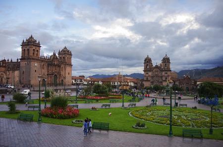Cathedral Basilica of the Assumption of the Virgin and Catedral Iglesia de la Compania de Jesus en Plaza de Armas in Cusco old city, Peru Editorial