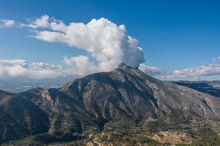 Clouds over top of Sierra de Bernia mountains range, near Benidorm, Spain