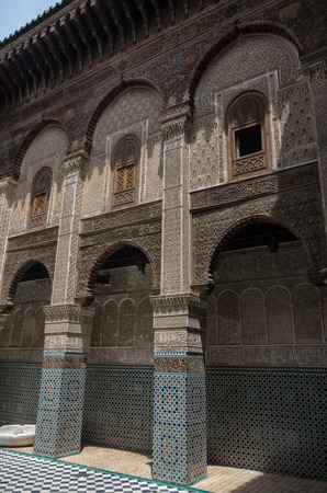fes: Fez, Morocco - May 9, 2017: Courtyard of Al-Attarine Madrasa is a madrasa in Fez medina in Morocco, near the Al-Qarawiyyin Fez Mosque Editorial