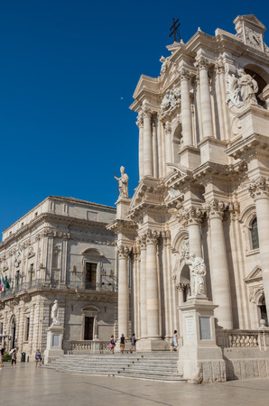 ortigia: Syracuse, Italy - August 31, 2017:  Baroque style Cathedral in piazza Duomo. Ortiga island, Syracuse city, in Sicily. The city is a historic town in Sicily, the capital of the province of Syracuse.