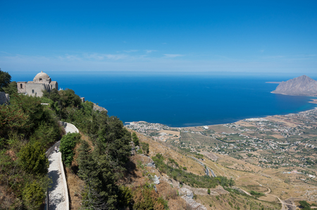 erice: Panoramic view to Tyrrhenian coastline with the Church of Saint John the Baptist. Erice Sicily, Italy