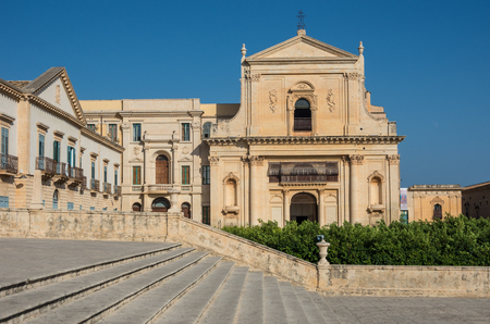 Noto, Italy - September 01, 2017: Basilica of saint savior (san salvatore) in Noto. View from stairway of cathedral of Noto. Sicily Italy