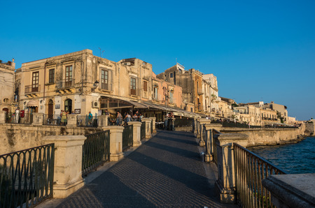 Syracuse, Italy - August 31, 2017: Sunset in Embankment of Ortygia island, Syracuse city, in Sicily.