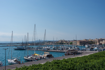 ortigia: Syracuse, Italy - August 31, 2017:  The harbor of Syracuse on the island Ortygia, Sicily, Italy.