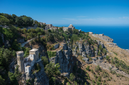 erice: Panoramic view to Tyrrhenian coastline with the Church of Saint John the Baptist and Torretta Pepoli - little castle in Erice, Sicily, Italy Stock Photo