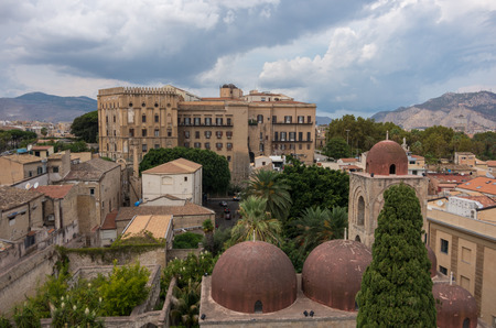 The famous red domes of the Church of St. John of the Hermits (San Giovanni degli Eremiti) and the Norman Palace (Palazzo dei Normanni) - Palermo, Sicily, Italy