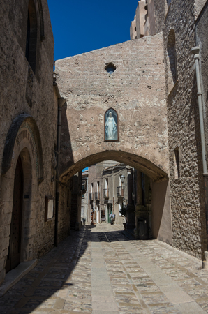 Narrow ancient cobblestone street of medieval town Erice, Sicily, Italy