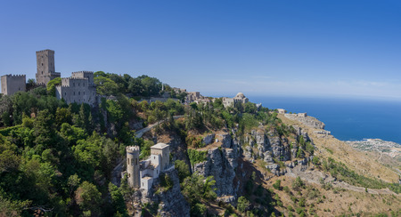 erice: Panoramic view to Tyrrhenian coastline with the Church of Saint John the Baptist, norman castle called Torri del Bali, Torretta Pepoli - little castle in Erice, Sicily, Italy