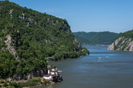Mraconia Monastery - Danube gorge, Danube in Djerdap (Iron gates) national park, Serbia, Romania 스톡 콘텐츠