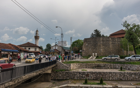 Novi Pazar, Serbia - May 5, 2018: City center with and fortress ruin and mosque. Novi Pazar, town of southern Serbia.