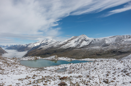 View to Stausee lake near Saas Fee in the southern Swiss Alps from Monte Moro pass, Italy Zdjęcie Seryjne
