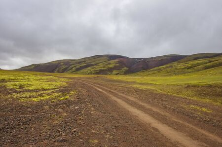 Dirt road to Thjofadalir valley in Iceland highlands. Cloudy summer day.