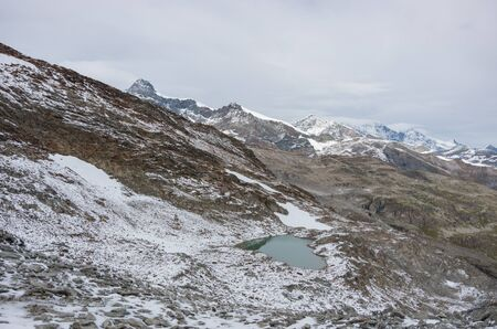 View from Monte Moro pass to mountain range near Stausee lake in the southern Swiss Alps, Italy