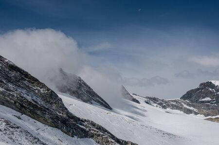 View of Seewjinengletscher glacier in Monte Rosa massif. Schwarzberghorn mount at background. Switzerland