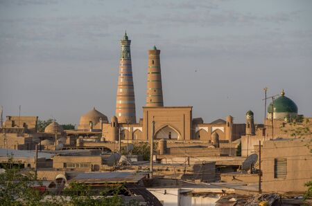 Panoramic view of roofs and minarets of Khiva old town in morning light - Khiva, Uzbekistan