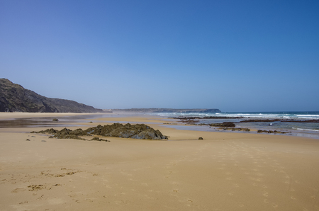 A view of beautiful Bordeira beach, famous surfing place in Algarve region, Portugal