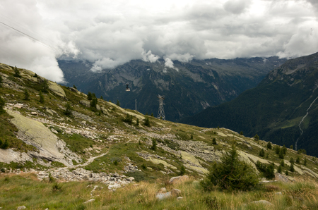 View to cable car line of slope of Monte Moro mount near villages of Macugnaga (Staffa - Pecetto) and Borca, Piedmont, Italy