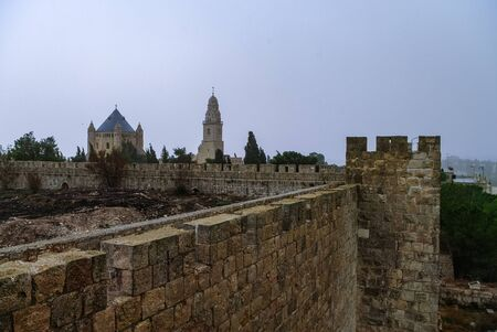 Old town wall and Franciscan monastery of dormition on mount Zion in Jerusalem, Israel