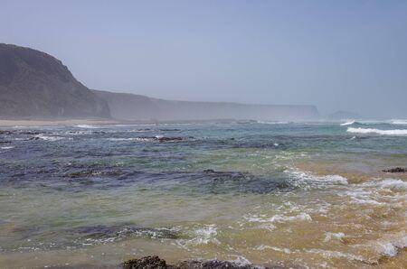 Cliffs on Praia da Fateixa. Arrifana Atlantic sea coast in Algarve, the south of Portugal.