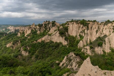 Rozhen pyramids -a unique pyramid shaped mountains cliffs in Bulgaria, near Melnik town.