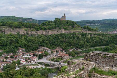 Panoramic view of the Tsarevets Fortress from ruins of Trapezitsa fortress. Veliko Tarnovo in Bulgaria.