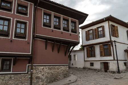 View of a narrow street in  historical part of  Plovdiv Old Town. Typical medieval colorful buildings. Bulgaria