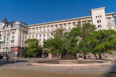Sofia, Bulgaria - May 3, 2019: Fountain at Atanas Burov Square with Presidency building at background Sofia, Bulgaria Editorial