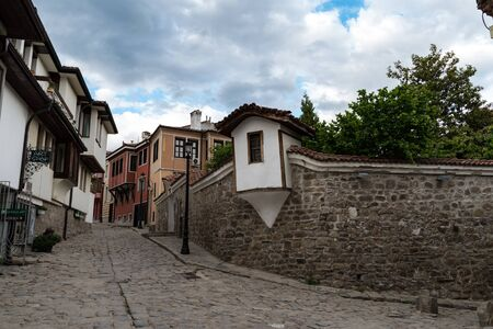 Plovdiv, Bulgaria - May 6, 2019: View of a narrow street in  historical part of  Plovdiv Old Town. Typical medieval colorful buildings. Bulgaria Editorial
