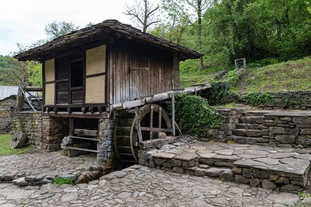 Old watermill in architectural ethnographic complex