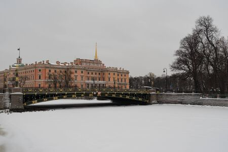 The facade of the Mikhailovsky (engineers) castle and the river Moika in Saint-Petersburg, Russia Editorial