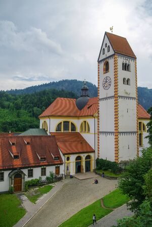Clock tower of Hohes schloss, medieval castle in the middle of Fussen old town, Bavarian Alps, Germany