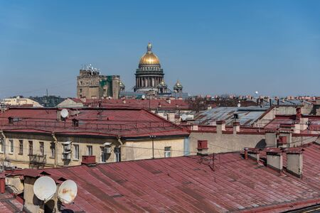 View on roofs of old buildings historic center of Sankt Peterburg and dome of St Isaac Cathedral. Russia