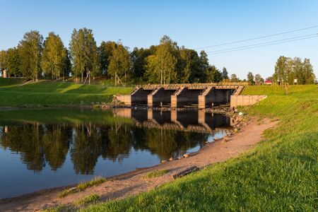 Newly restored elements of historical Tikhvin water system - wooden sluice. One of the landmark of Tikhvin, Russia