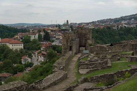 Gate tower and ruins of Tsarevets fortress with a view of the old town of Veliko Tarnovo in the background, Bulgaria
