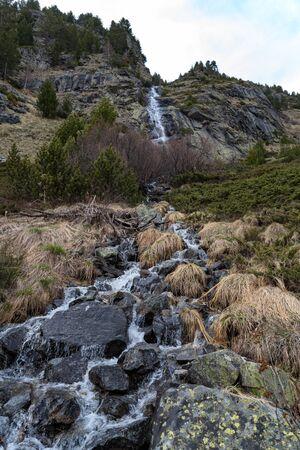 Little waterfall near mountain lake Sukhato in Rila range , Rila mountains, Bulgaria