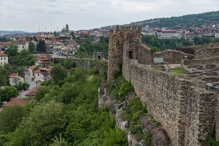 Veliko Tarnovo, Bulgaria - 8 may, 2019: Gate tower and ruins of Tsarevets fortress with a view of the old town of Veliko Tarnovo in the background, Bulgaria
