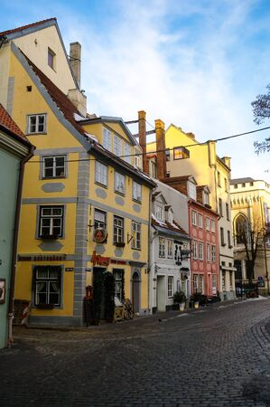 Riga, Latvia - March 7, 2011: Traditional medieval houses in Livu square. Riga old town.