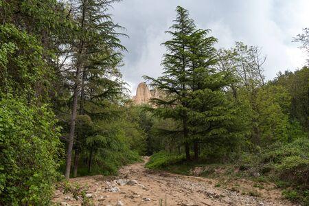Hiking trail thru Rozhen pyramids area, unique pyramid shaped mountains cliffs in Bulgaria, near Melnik town.