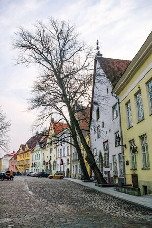 Tallinn, Estonia - March 27, 2010: Narrow street with medieval houses in old town of Tallinn, Estonia Banco de Imagens