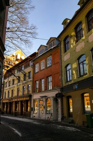 Riga, Latvia -  7 March, 2011: Traditional medieval houses in street of Riga old town. Winter and snow.