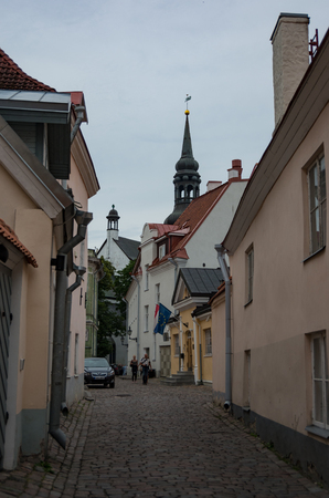 Tallinn, Estonia - July 29, 2017: Narrow street in the old town on Toompea Hill of Tallinn with St Marys Cathedral (Dome Church) at background, Estonia Editorial