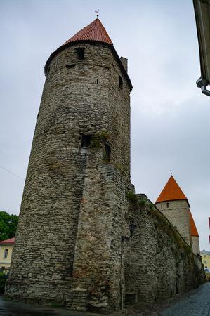 Walls of Tallinn are medieval defensive walls constructed around city of Tallinn. Plate torn. Estonia Editorial