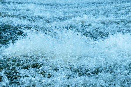 rages: Water on a threshold of the river is rolled and rages