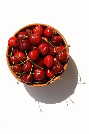 sweet cherry in brown cup isolated Stock Photo