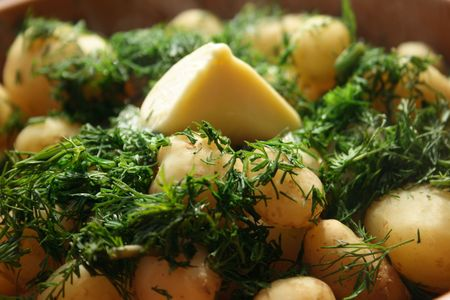 simply: Boilled young potato with dill and butter. Its very simply and tasty dish. Stock Photo