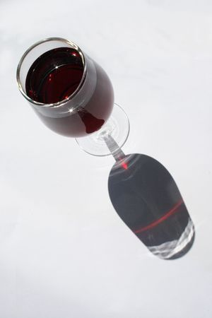 glasswear: red wine in glass on white background